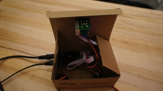 The amp board is housed inside the box it came with!